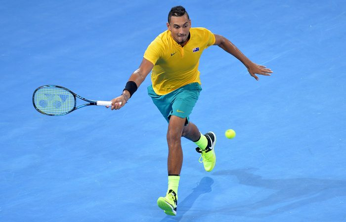 BRISBANE, AUSTRALIA - APRIL 07:  Nick Kyrgios of Australia stretches out to play a forehand in his match against John Isner of the USA during the Davis Cup World Group Quarterfinals between Australia and the USA at Pat Rafter Arena on April 7, 2017 in Brisbane, Australia.  (Photo by Bradley Kanaris/Getty Images)