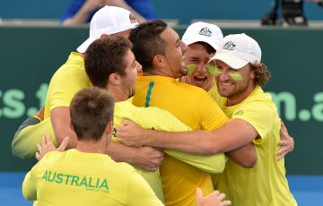 BRISBANE, AUSTRALIA - APRIL 09:  Nick Kyrgios of Australia celebrates victory with team mates after his match against Sam Querrey of the USA during the Davis Cup World Group Quarterfinals between Australia and the USA at Pat Rafter Arena on April 9, 2017 in Brisbane, Australia.  (Photo by Bradley Kanaris/Getty Images)