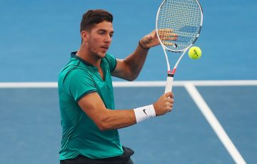 Thanasi Kokkinakis in action in the doubles event at Brisbane International 2017; Getty Images