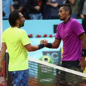 Nick Kyrgios (R) shakes hands with Marcos Baghdatis after winning their first-round match at the Mutua Madrid Open; Getty Images