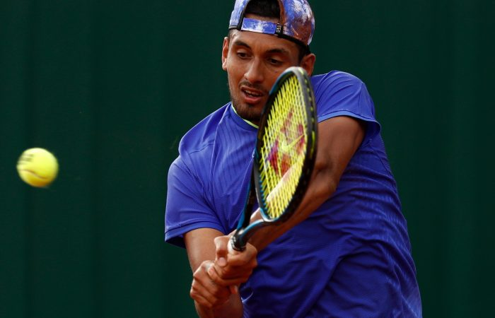 Nick Kyrgios lines up a backhand during his second round loss at Roland Garros 2017; Getty Images