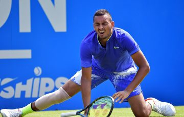 Nick Kyrgios slips on the grass at London's Queen's Club, and later retired from his first-round match against Donal Young; Getty Images