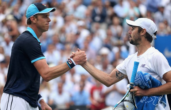 Sam Querrey (L) shakes hands with Jordan Thompson after beating the Aussie in the second round at Queen's Club; Getty Images