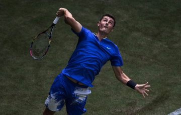 Bernard Tomic serves to Tommy Haas in his first-round victory over the German in Halle; Getty Images