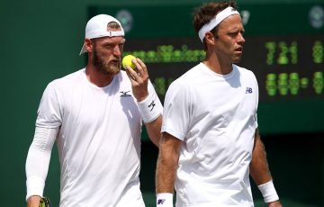 Sam Groth (L) and Robert Lindstedt compete in the men's doubles event at Wimbledon; Getty Images