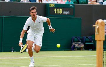 Thanasi Kokkinakis tracks down a shot during his four-set first-round loss to Juan Martin del Potro at Wimbledon; Getty Images