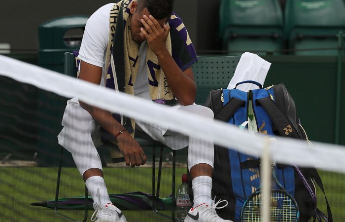 Nick Kyrgios cuts a forlorn  figure during his injury-induced first-round loss at Wimbledon to Pierre-Hugues Herbert; Getty Images