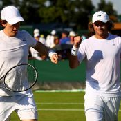 John-Patrick Smith (L) and Matt Reid in action in the men's doubles at Wimbledon; Getty Images
