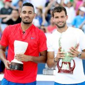 Nick Kyrgios (L) and Grigor Dimitrov pose with their trophies after the Cincinnati Masters final; Getty Images