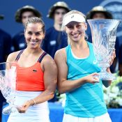 Daria Gavrilova (R) and Dominika Cibulkova pose with their trophies after the New Haven final; Getty Images
