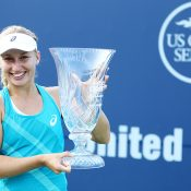 Daria Gavrilova poses with her champion's trophy after winning the WTA Connecticut Open in New Haven; Getty Images