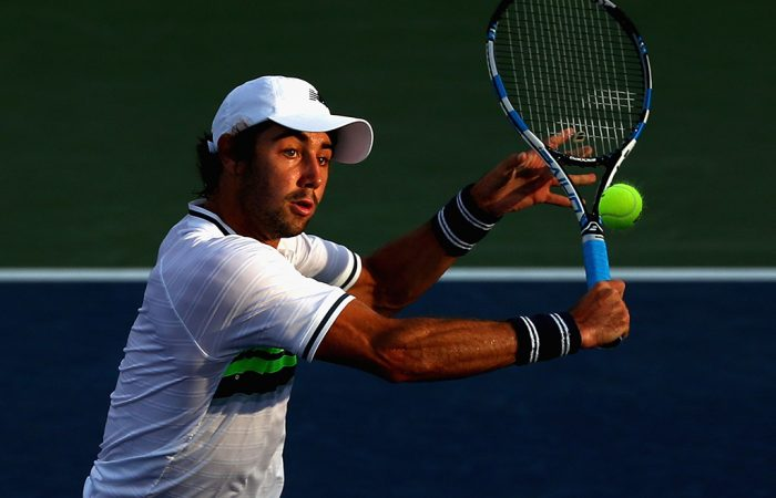 Jordan Thompson volleys during his five-set win over Jack Sock in the first round of the US Open; Getty Images