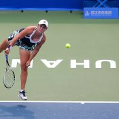 Ash Barty serves to CiCi Bellis during her first-round victory at the WTA tournament in Wuhan; Getty Images