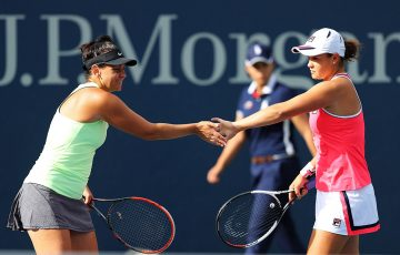 Casey Dellacqua (L) and Ash Barty in action at the US Open in 2017; Getty Images