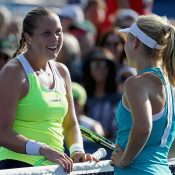 Daria Gavrilova (R) and Shelby Rogers meet at the net after their epic US Open second-round match; Getty Images