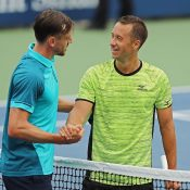 John Millman (L) shakes hands with Philipp Kohlschreiber after going down in their third-round match at the US Open; Getty Images