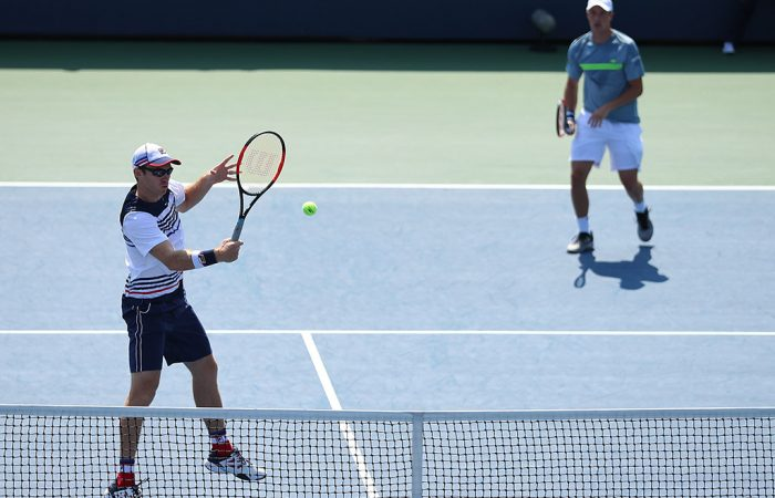 John Peers (L) volleys en route to victory with Henri Kontinen in the first round of the men's doubles at the US Open; Getty Images