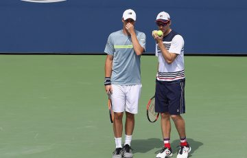 John Peers (R) and Henri Kontinen discuss tactics during their semifinal loss at the US Open to Jean-Julien Rojer and Horia Tecau; Getty Images