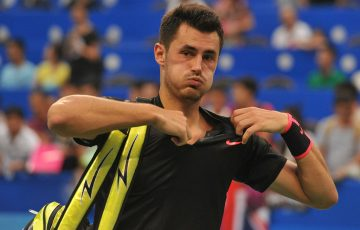 Bernard Tomic exits the court following his first-round loss at the ATP Chengdu Open; Getty Images