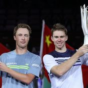 John Peers (R) and Henri Kontinen hoist their Shanghai Masters champions' trophies; Getty Images