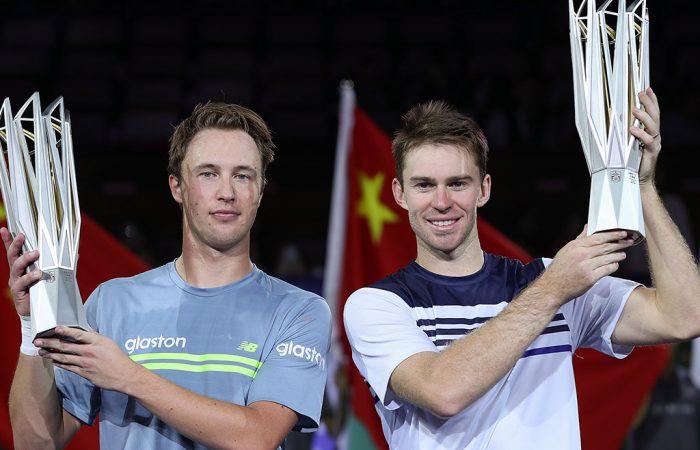 John Peers (R) and Henri Kontinen hoist their Shanghai Masters champions' trophies; Getty Images