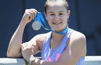Ash Barty poses with the Newcombe Medal at the National Tennis Centre the day after the glittering ceremony at Melbourne's Palladium Ballroom; Getty Images