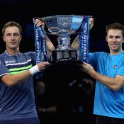 John Peers (R) and Henri Kontinen hoist the trophy after winning the ATP Finals for a second straight year in London; Getty Images