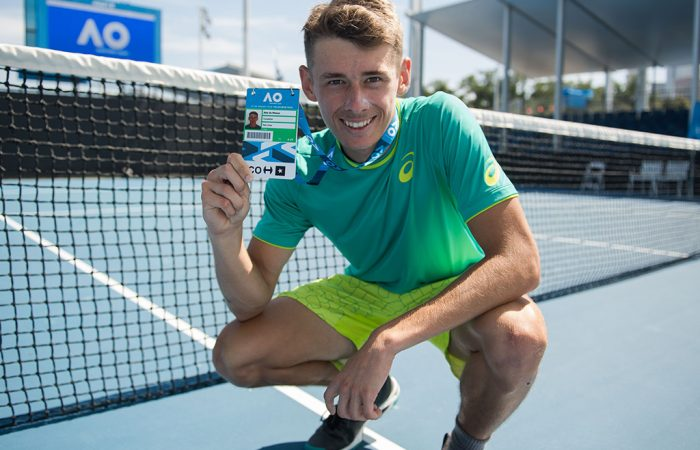 Alex De Minaur poses with his Australian Open 2018 player accreditation after winning the AO Play-off (photo credit Elizabeth Xue Bai)