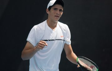 Alexander Crnokrak celebrates his victory over Benard Nkomba in the final of the 18/u Australian Championships at Melbourne Park; Elizabeth Xue Bai