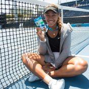 Destanee Aiava poses with her Australian Open 2018 player accreditation (photo credit Elizabeth Xue Bai)