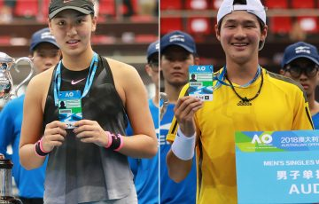 Xinyu Wang (L) and Soon Woo Kwon pose with their Australian Open player accreditation passes after winning the women's and men's singles events at the Asia-Pacific Wildcard Play-off in Zhuhai.
