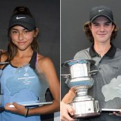 Anastasia Berezov (L) and Cooper White pose with their 14/u Australian Championships trophies at Melbourne Park (photo credit Elizabeth Xue Bai)