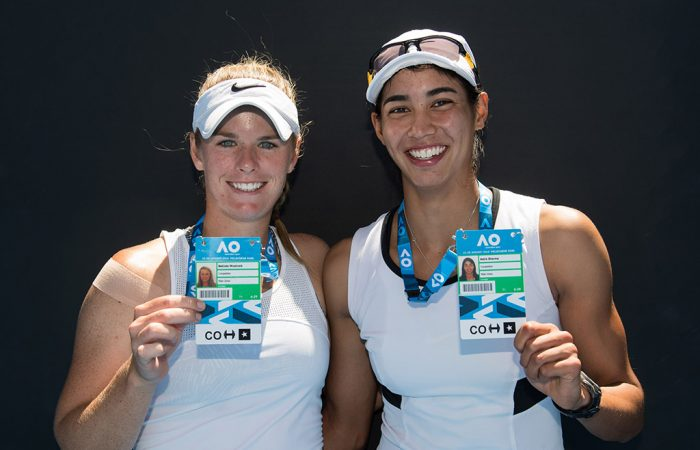 Belinda Woolcock (L) and Astra Sharma pose with their Australian Open player accreditations after winning the women's doubles AO Play-off event at Melbourne Park (photo credit Elizabeth Xue Bai)
