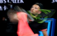 Dylan Alcott strikes a backhand during a straight-sets win on Rod Laver Arena.
