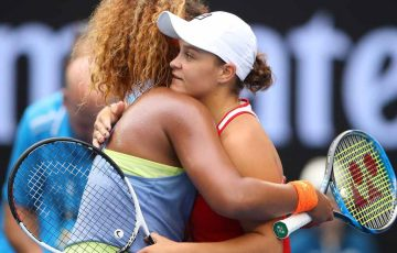 Osaka and Barty embrace at the net following their third round encounter.