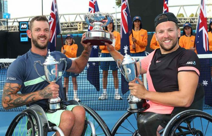 Heath Davidson and Dylan Alcott with their doubles title at Melbourne Park.
