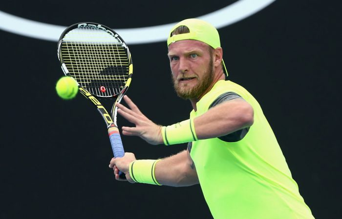 Sam Groth prepares to strike a forehand against Taylor Fritz