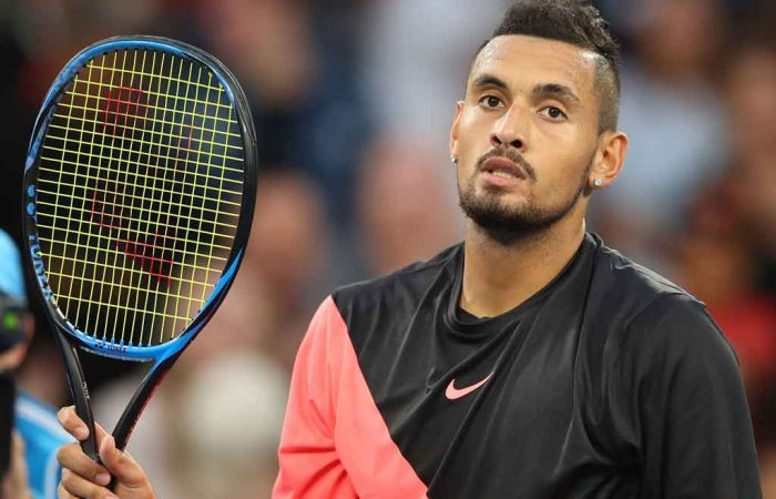 Nick Kyrgios salutes the crowd after dropping just seven games in the first round.