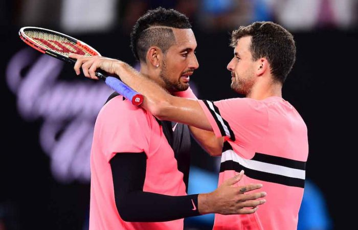 Nick Kyrgios and Grigor Dimitrov embrace after a remarkable match on Rod Laver Arena.