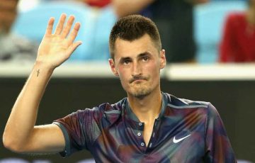 Bernard Tomic salutes the crowd at Melbourne Park.