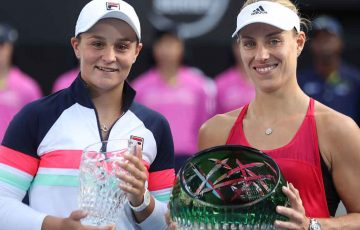 Ash Barty and Angelique Kerber hold their Sydney International trophies.