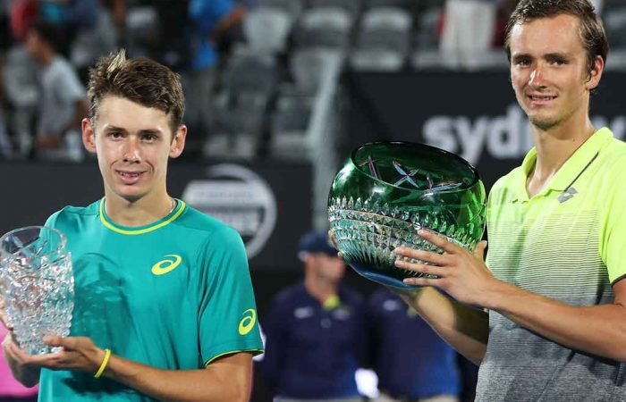 De Minaur and Medvedev with their Sydney trophies.