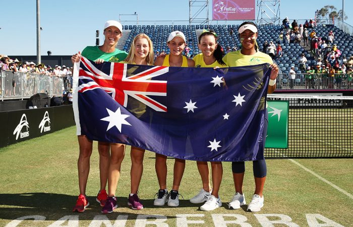 Australia's Fed Cup team of (L-R) Alicia Molik, Daria Gavrilova, Ash Barty, Casey Dellacqua and Destanee Aiava celebrate their World Group II first-round victory against Ukraine in Canberra; Getty Images