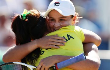 Ash Barty (R) and Casey Dellacqua embrace after winning their doubles rubber to seal a 3-2 victory for Australia in Fed Cup against Ukraine in Canberra; Getty Images