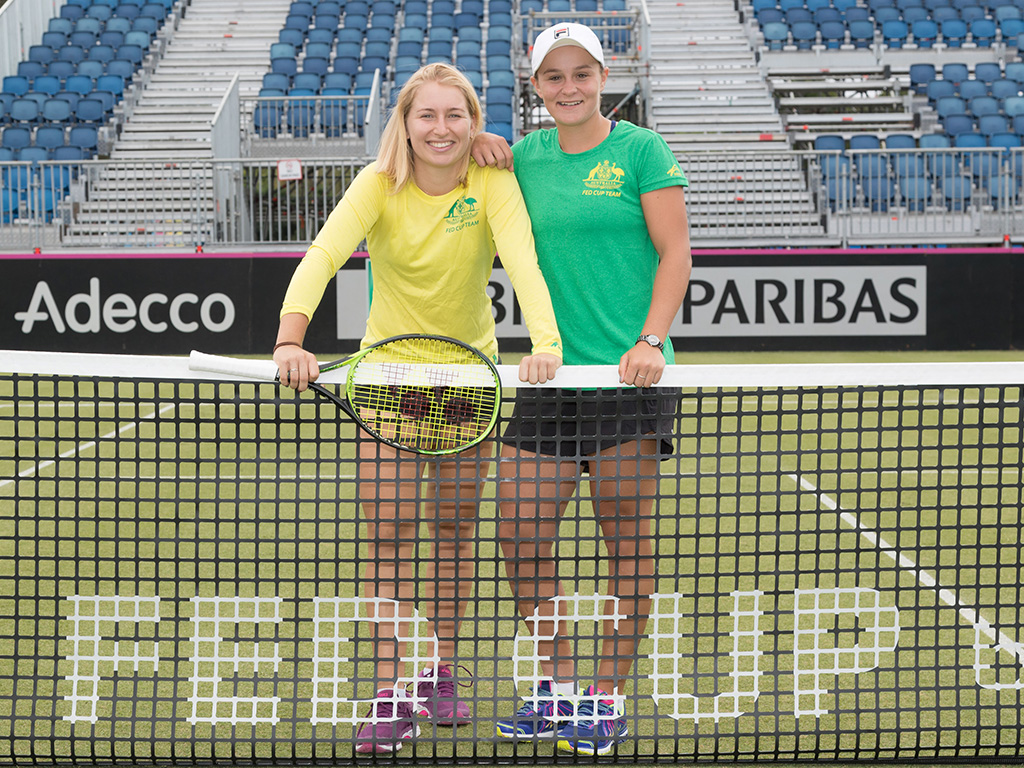 Ash Barty (R) and Daria Gavrilova pose on the grass court in Canberra ahead of Australia's Fed Cup tie against the Ukraine.