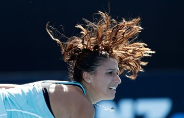 MELBOURNE, AUSTRALIA - JANUARY 15:  Jaimee Fourlis of Australia serves in her first round match against Olivia Rogowska of Australia on day one of the 2018 Australian Open at Melbourne Park on January 15, 2018 in Melbourne, Australia.  (Photo by Michael Dodge/Getty Images)
