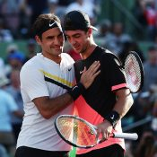 Thanasi Kokkinakis (R) is congratulated by Roger Federer (L) after winning through to the third round of the Miami Open; Getty Images