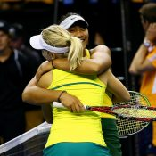 Destanee Aiava (R) and Daria Gavrilova celebrate their victory in the doubles rubber to give Australia a 4-1 victory over Netherlands in the fed Cup World Group Play-off tie in Wollongong; Getty Images