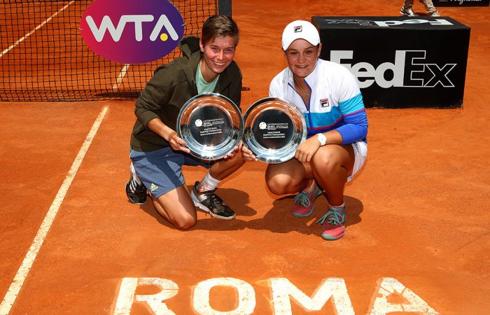 CHAMPIONS: Demi Schuurs and Ash Barty celebrate after winning the doubles title in Rome; Getty Images