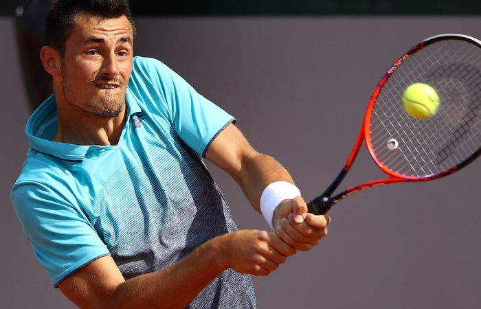 PARIS, FRANCE - MAY 25:  Bernard Tomic of Australia plays a backhand during his French Open third round menÕs qualifying singles match against Goncalo Oliveira of Portugal at Roland Garros on May 25, 2018 in Paris, France.  (Photo by Cameron Spencer/Getty Images)